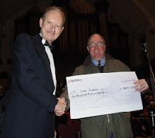 Jonathan Smith, RPC Chair, presents cheque to Peter Green in aid of the Arnold Foundation.